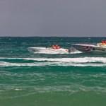 Speedboats pass Scarborough in the Carib Great Race. Photographer: Martin Kellner