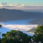Mist crawls through the valleys of the Northern Range at dawn. Photo by Chris Anderson