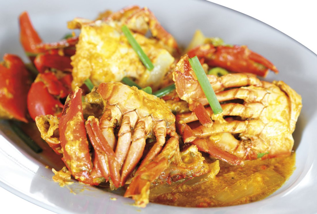 Curried crab and dumpling is a must-eat in Tobago. Photo by Bennyartist/Shutterstock