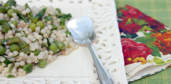 Cous cous with asparagus and peas