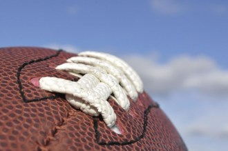 Close-up of American Football Texture and Laces with Selective Focus