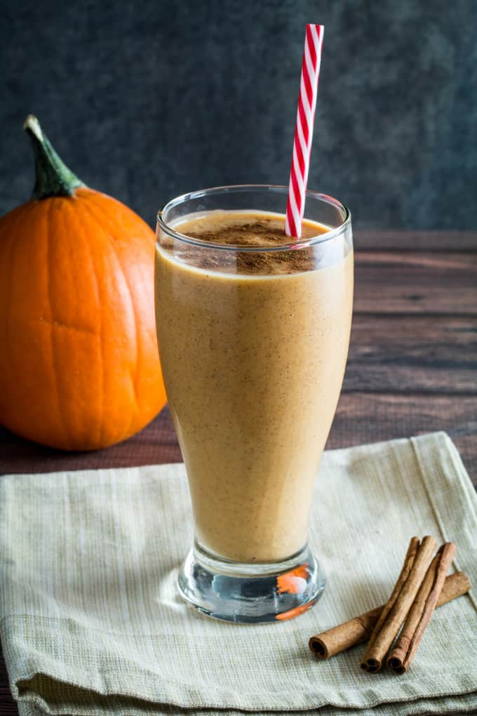 Creamy, smooth, and sinfully sweet, you won't believe how easy this Breakfast Pumpkin Pie Smoothie is to make! With nutritious oatmeal and yogurt, this smoothie tastes exactly like pumpkin pie in a glass, bringing the flavors of autumn to your breakfast table. Best of all, it's like having dessert for breakfast!