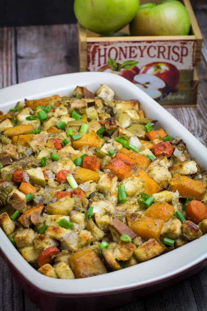 Savory, sweet, and packed with the flavors of herbs and autumn vegetables, this Root Vegetable Gluten Free Stuffing is the perfect addition to your Thanksgiving table. Apples, raisins, and apple cider come together with a mix of root vegetables, gluten free bread, herbs, and a buttery vegetable broth to bring your holiday stuffing to the next level.