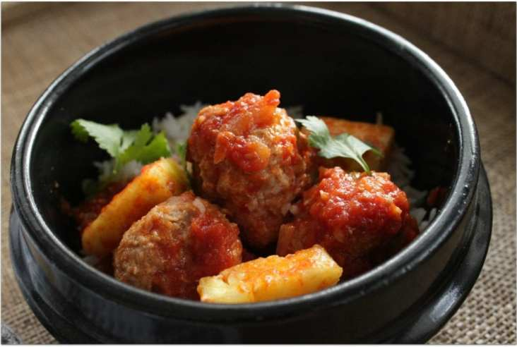 The Sweet and Sour Meatballs aren't your run of the mill meatballs. The addition of smoky paprika, chili flakes, and pineapple take this old school treat to a new level! #meatballs #sweetandsour #sweetandsourmeatballs #dinner