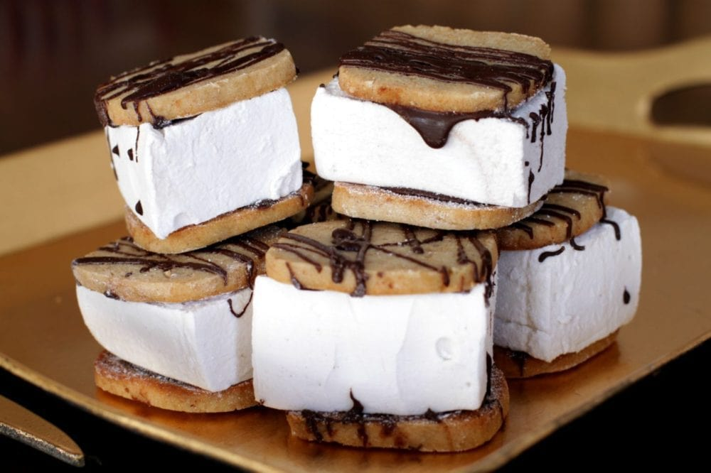 S'mores are a campfire favourite you can create right from scratch. Then enjoy these soft, vanilla flavoured marshmallows sandwiched between crumbly graham cookies...hot or cold! #smores #marshmallows #dessert #grahamcrackers
