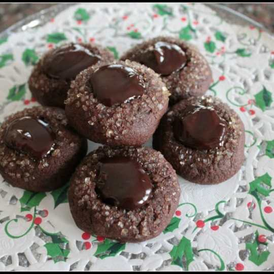 These Rockin' Bailey's Thumbprint Cookies are a new take on the ever so popular Thumbprint cookie. Bake them with Bailey's Irish Cream, extra chocolate, and a scattering of coarse sugar for an extra treat.#cookies #Baileys #ChristmasCookies