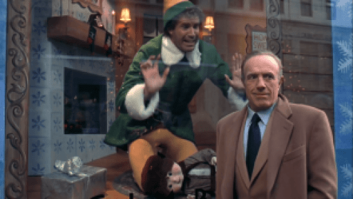 Will Ferrell in a window dressed as an Elf. James Caan shows there are wealthy holiday workers