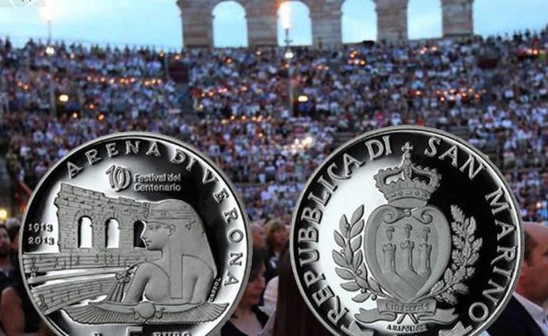 È stata emessa dall'Azienda autonoma di Stato filatelica e numismatica di San Marino la moneta in argento da cinque euro dedicata all' «Arena di Verona Festival del Centenario 1913 - 2013». Si tratta di una moneta celebrativa in argento proof a disponibile per tutti gli appassionati ed i collezionisti. L'effige rimanda immediatamente ad Aida, l'opera più rappresentata all'Arena di Verona e che cento anni fa ha dato il via al Festival lirico, il 10 agosto 1913. Da quella data l'anfiteatro scaligero è diventato il teatro all'aperto più grande del mondo. Il rovescio della moneta esemplifica il ritratto dell'eroina Aida con la raffigurazione di un profilo femminile ed elementi egizi che suggeriscono l'ambientazione esotica dell'opera di Giuseppe Verdi. In secondo piano, un particolare dell'Arena con la celebre «ala» e le gradinate trasformate idealmente in un pentagramma per un immediato richiamo alla musica. Infine compare la dedica al Festival areniano con le date 1913-2013 e la presenza del logo del Festival del Centenario. Nel dritto della moneta compare lo stemma di Stato della Repubblica di San Marino.