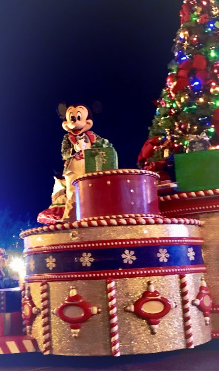 "Mickey's Once Upon a Christmastime Parade Wave to your Disney friends during this holiday parade brimming with magic and cheer! Festive gingerbread men, elves and others dance down Main Street, U.S.A. alongside Disney Characters that include: Mickey and Minnie Goofy Anna and Elsa Olaf Pooh and Tigger The Seven Dwarfs And many more—not to mention Santa, wishing you a ""Merry Christmas!"" from his colorful sleigh!"