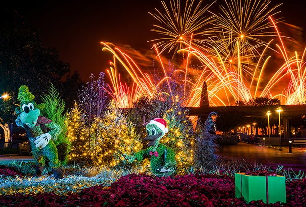illuminations-peace-on-earth-holiday-tag-goofy-donald-topiaries