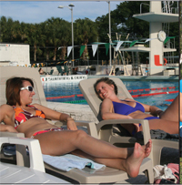 Australian exhange students, Carly Mills and Caitlin Judd enjoy the Miami sun and relaz at the pool.