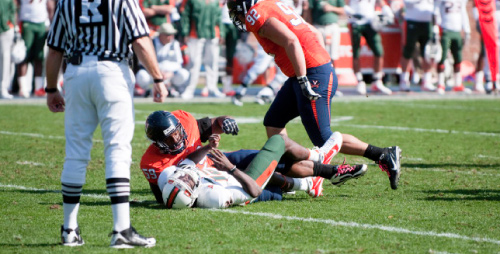 Jacory Harris lies on the ground after being taken down by defensive tackle John-Kevin Dolce at the Miami vs. Virginia game in October.