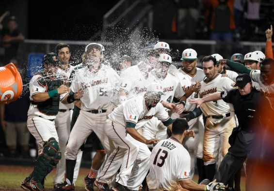 Miami players celebrate Willie Abreu's walk-off home run Friday night to beat Clemson, 9-8 / Hurricanesports
