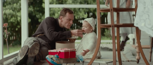 Michael with their child Lucie in The Light Between Oceans. The film was released on Sept. 2, 2016.