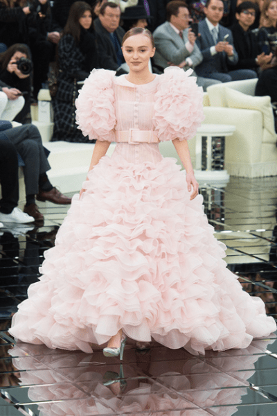 Lily Rose Depp, wearing a pink evening gown to mark the end of the Chanel Haute Couture Fashion Show SS17. Source: Elle Magazine.