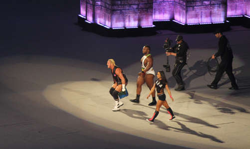 A.J., Dolph Ziggler and Big E. Langston make their way to the ring.