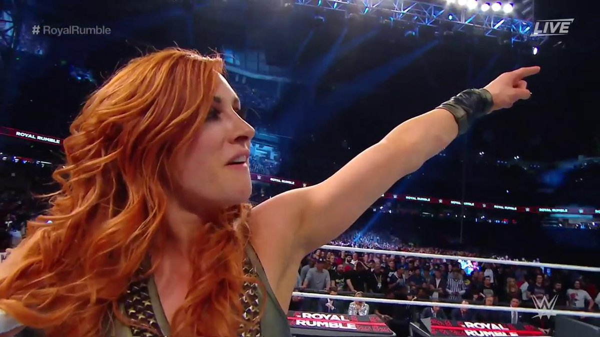 https://i2.wp.com/www.diva-dirt.com/wp-content/uploads/2019/01/Becky-Lynch-Pointing-at-the-WrestleMania-Sign.jpg?fit=1200%2C675