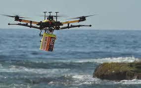 רחפן באוסטרליה נושא מזרן ים לחילוץ CREDIT:  AFP