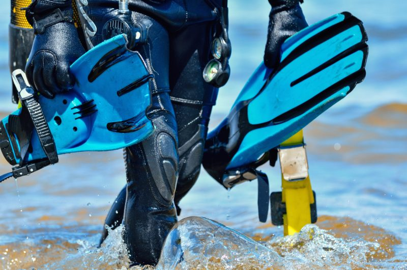 diver-with-fins-walking-out-of-water