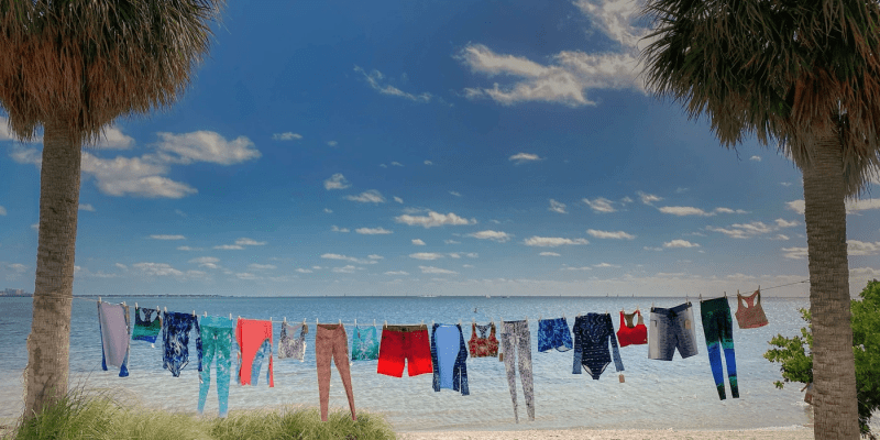 waterlust-environmentally-responsible-clothing-apparel-recycled-clothes-on-a-line-at-the-beach