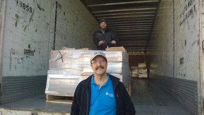 Division 9 Flooring Inventory/Warehouse/Safety Co-Chair Craig Bohrer loads flooring donations for Roger Johnson of Habitat for Humanity of Snohomish County in Lynnwood, Wash.