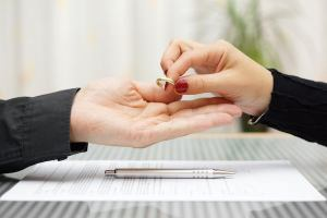 woman returned wedding ring to husband . Divorce concept