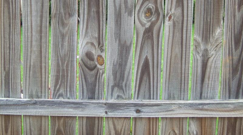 erecting wooden panel fence