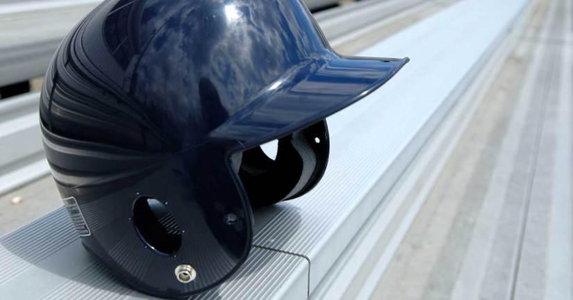 baseball helmet on bleachers representing more college baseball recruiting tips