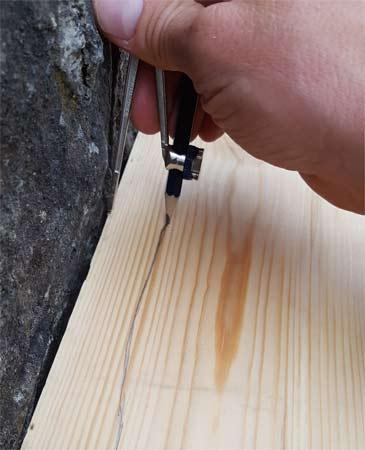 Tracer une surface inégale sur un morceau de bois