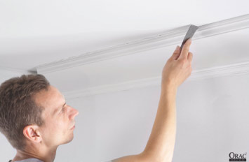 Remove excess adhesive from the edge of the coving