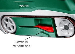 The belt release lever on the Bosch PBS 75 A
