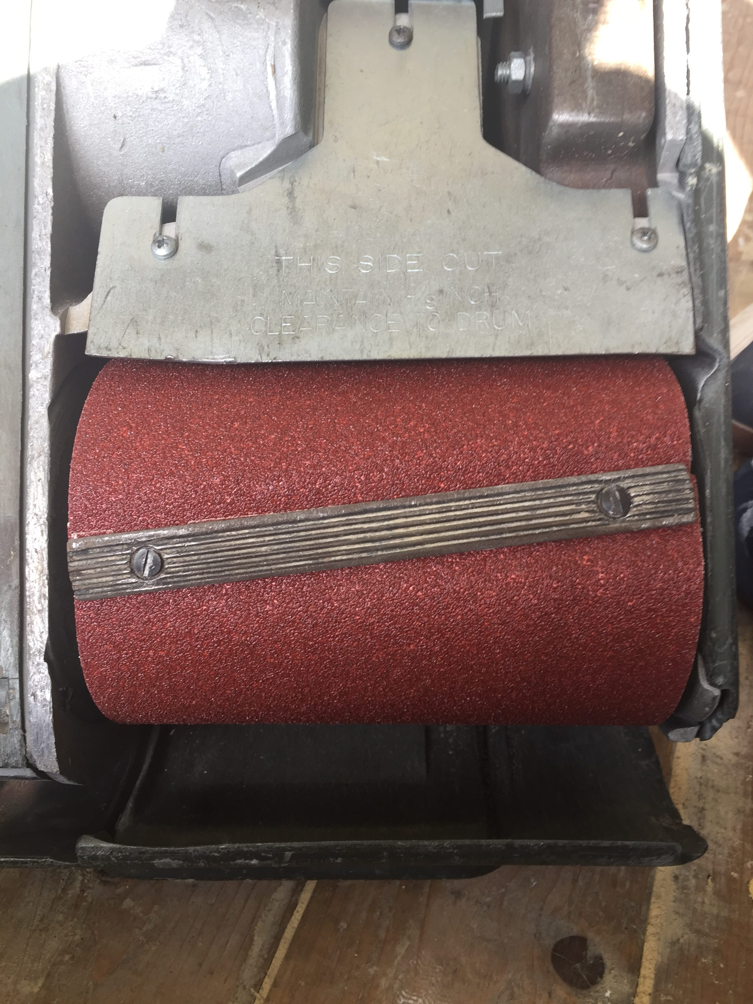 Drum sander with sandpaper