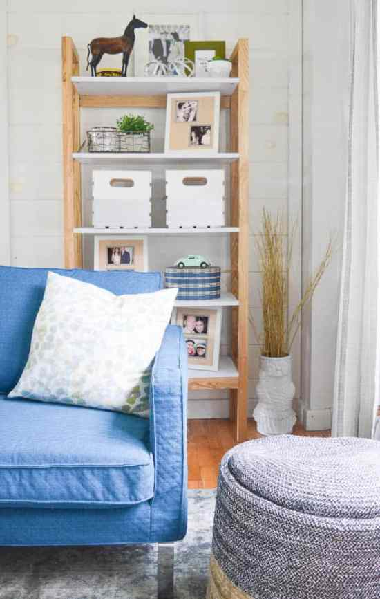 Planked Wall with open Bookshelf and Bright Blue Chair