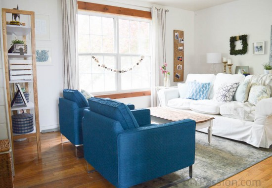 Rustic Coastal Living Room with White Couch and Blue Chairs