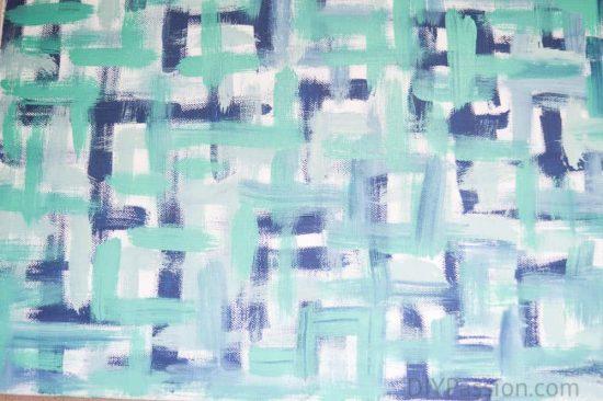 Close up of navy and aqua brush stroke art