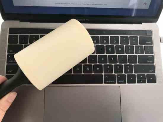 lint roller on a laptop