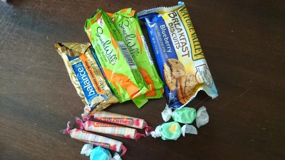 High protein bars for snacks plus some candy for fun.