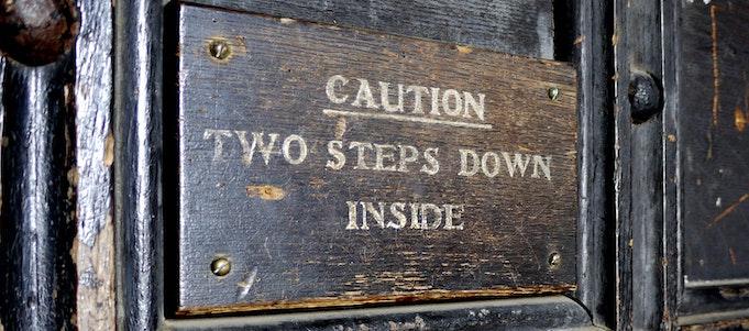 caution door sign print cons