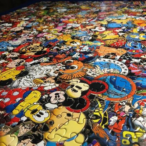 Mom and I helped @tintin7117 finish this Disney Pins puzzle .