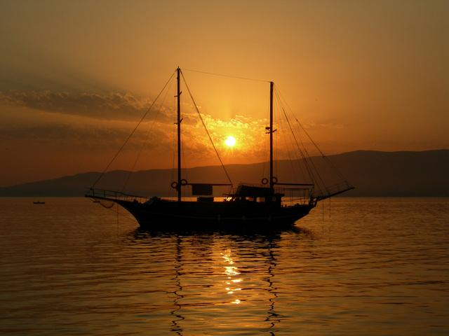 Ship in harbour at sunset