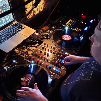 DJ Robzilla spinning music on turntables at a nightclub