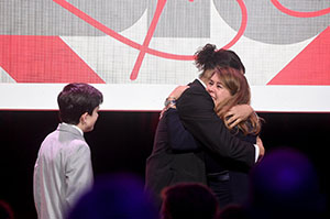 (L-R) Ezra Miller, Luis Miranda, and Cynthia Lowry share an emotional moment.