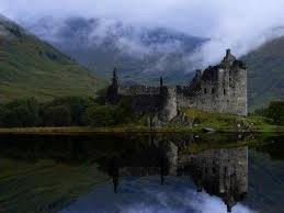a castle next to a river