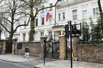FILE - A Russian flag flies outside Russia's embassy in central London, Britain, March 15, 2018.