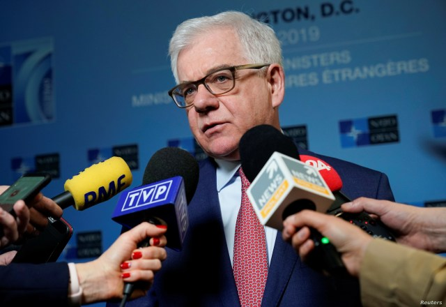FILE - Polish Foreign Minister Jacek Czaputowicz speaks to the media during the NATO Foreign Minister's Meeting at the State Department in Washington, April 4, 2019.