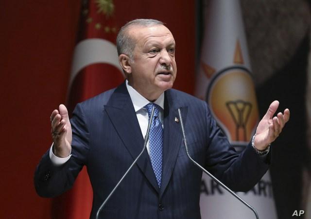 Turkey's President Recep Tayyip Erdogan addresses his ruling party members, in Ankara, Turkey, Friday, July 26, 2019.