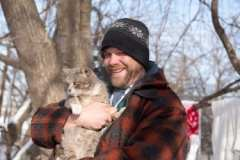 Eric briefly braves the cold with his cat, Camper.