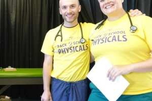 DMU students give kids a healthy start to the school year by offering free physicals.