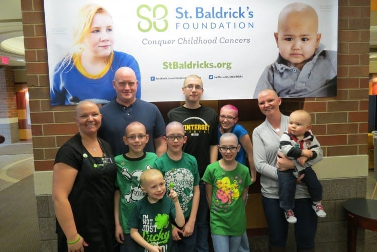 Melissa Rhoads, above far left, got her entire family in the St. Baldrick's spirit. At right, Kyle Bockelman, D.O.'16, loses his mane (but not the moustache). Photos: Bradley Krivit, D.O.'16