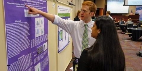 Faiza Choudhry, D.O.'17, answers questions from Marc Allan, D.O.'17, about her research poster